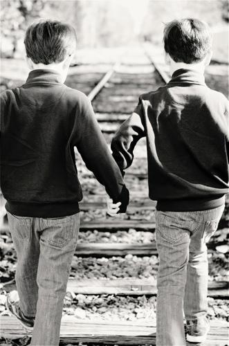 Zeller Twins Holding Hands